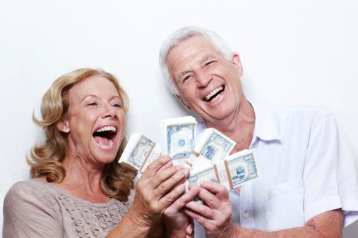happy-couple-with-money
