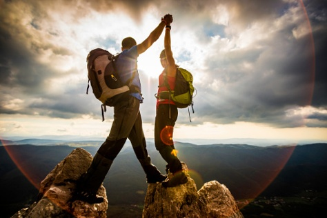 Woman And Man Hiking In Mountains